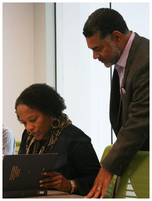 Alicia Dixon (sitting) and Board member Biff Clark look at Dr. Foster's thesis. It's the first time the institute viewed it.