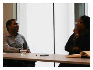 Professor Thomas M. Philip and MFEI Executive Director Alicia Dixon discuss the challenges of equity and inclusion in public schools. On the table is Dr. Marcus A. Foster's thesis, which is on loan from the University of Pennsylvania.